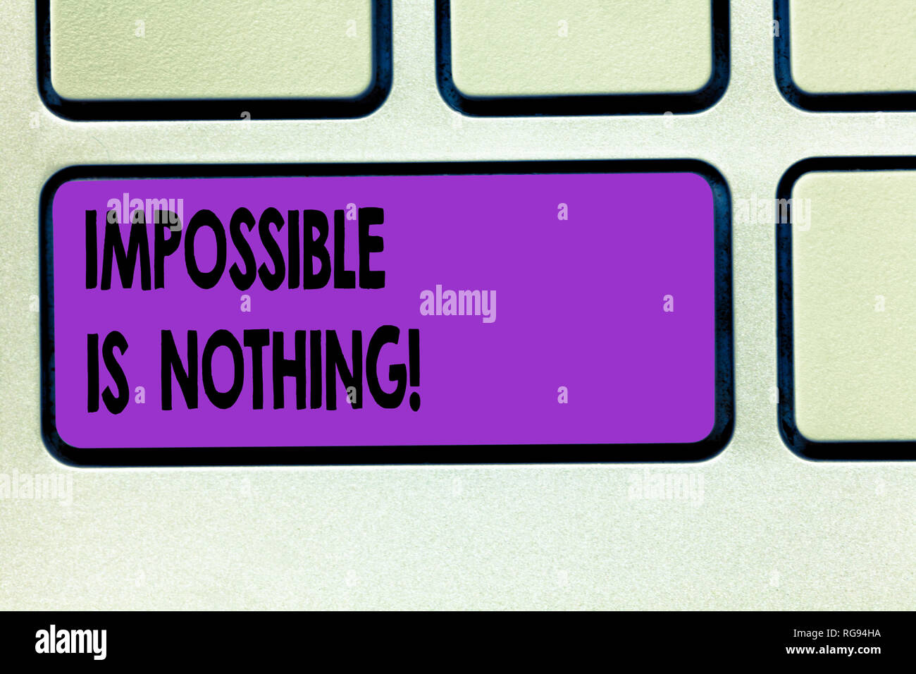 Word writing text Impossible Is Nothing. Business concept for Something which is very difficult to accomplish Keyboard key Intention to create compute Stock Photo