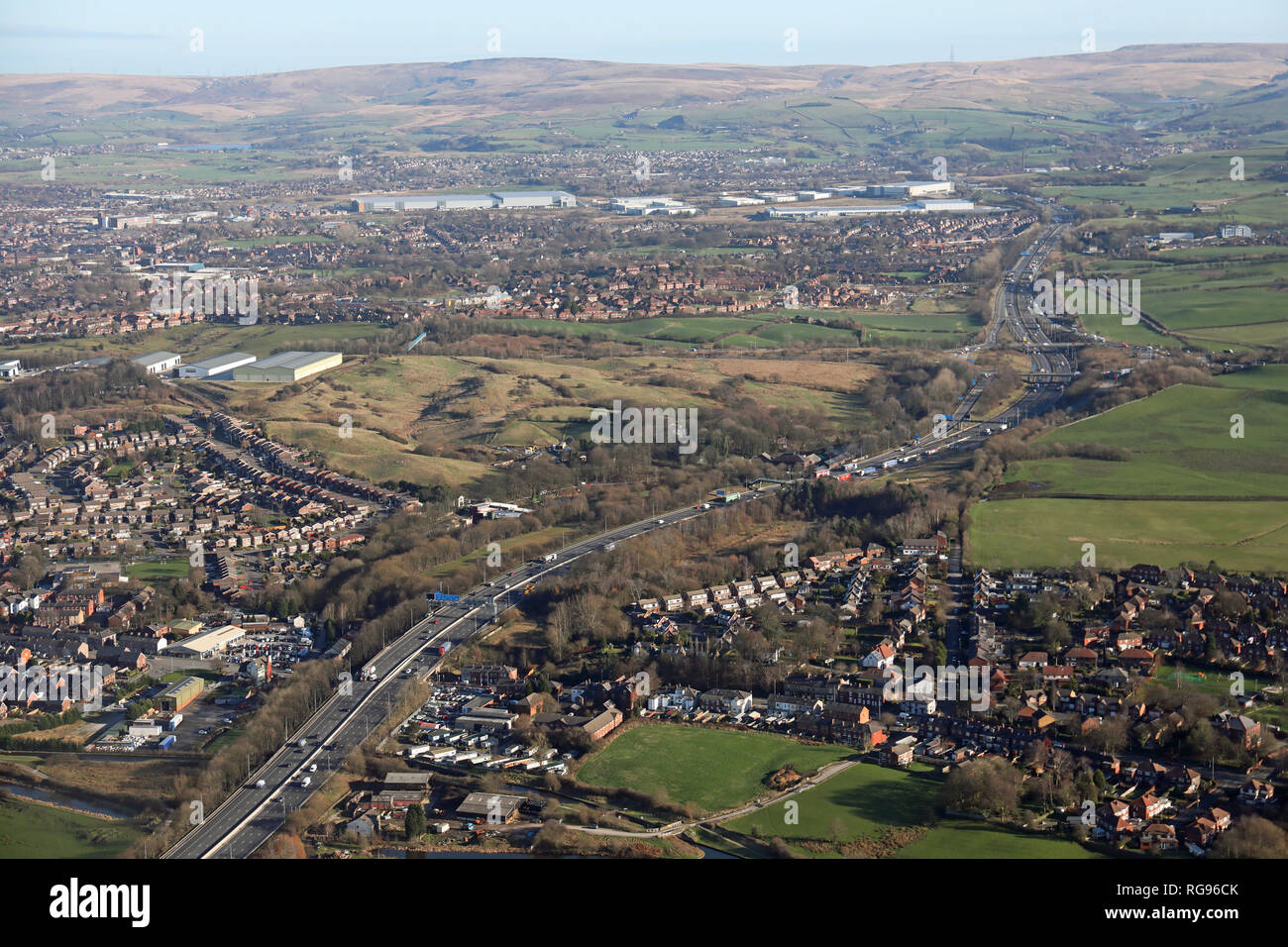 aerial view looking east along the M62 towards junction 20 from Castleton, north of Oldham, Greater Manchester - Stock Image
