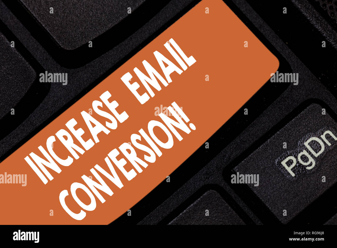 Handwriting text Increase Email Conversion. Concept meaning Action taking place on your landing page Keyboard key Intention to create computer message Stock Photo