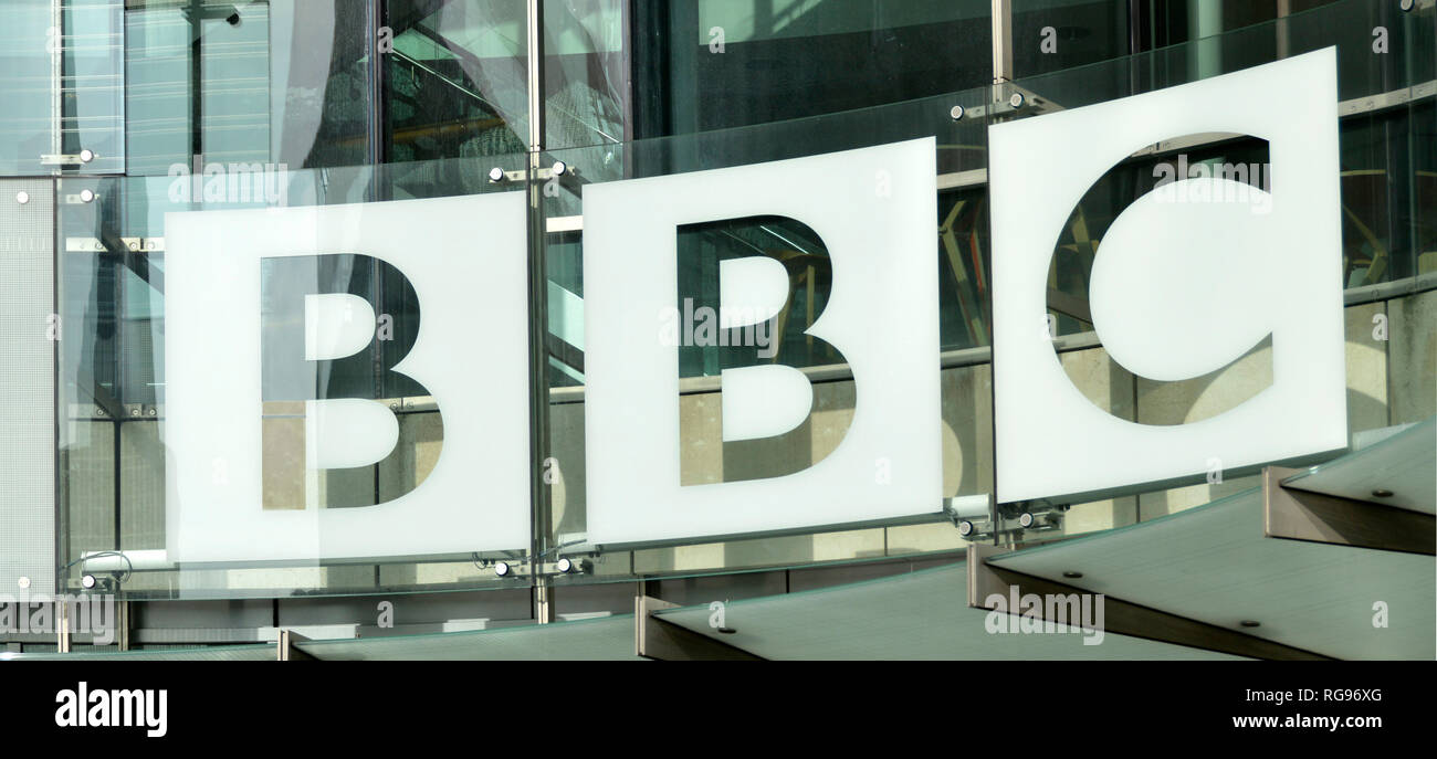 Close up BBC British Broadcasting Corporation sign logo & glass cladding on new modern HQ extension building at Broadcasting House London England UK - Stock Image