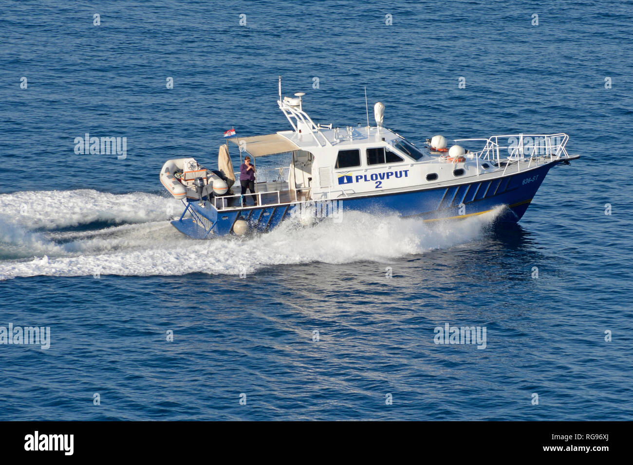 High speed Plovput motor boat seen from cruise ship returns to base after assisting liner captain in departing Split Croatia Dalmatian Adriatic Sea - Stock Image