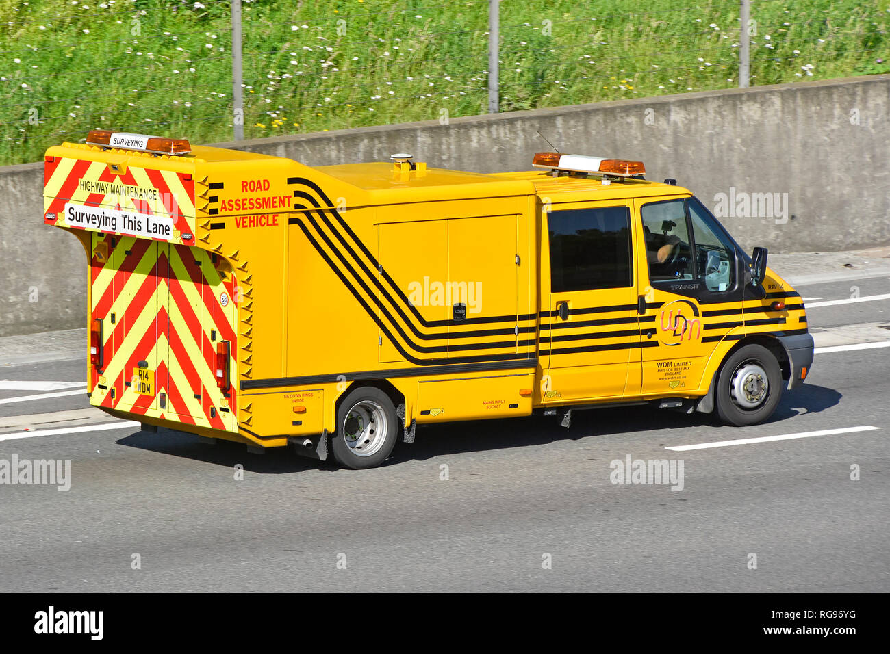 Specialised road surveying assessment vehicle for survey & recording of road surfaces to help prioritise maintenance work seen driving on UK motorway Stock Photo