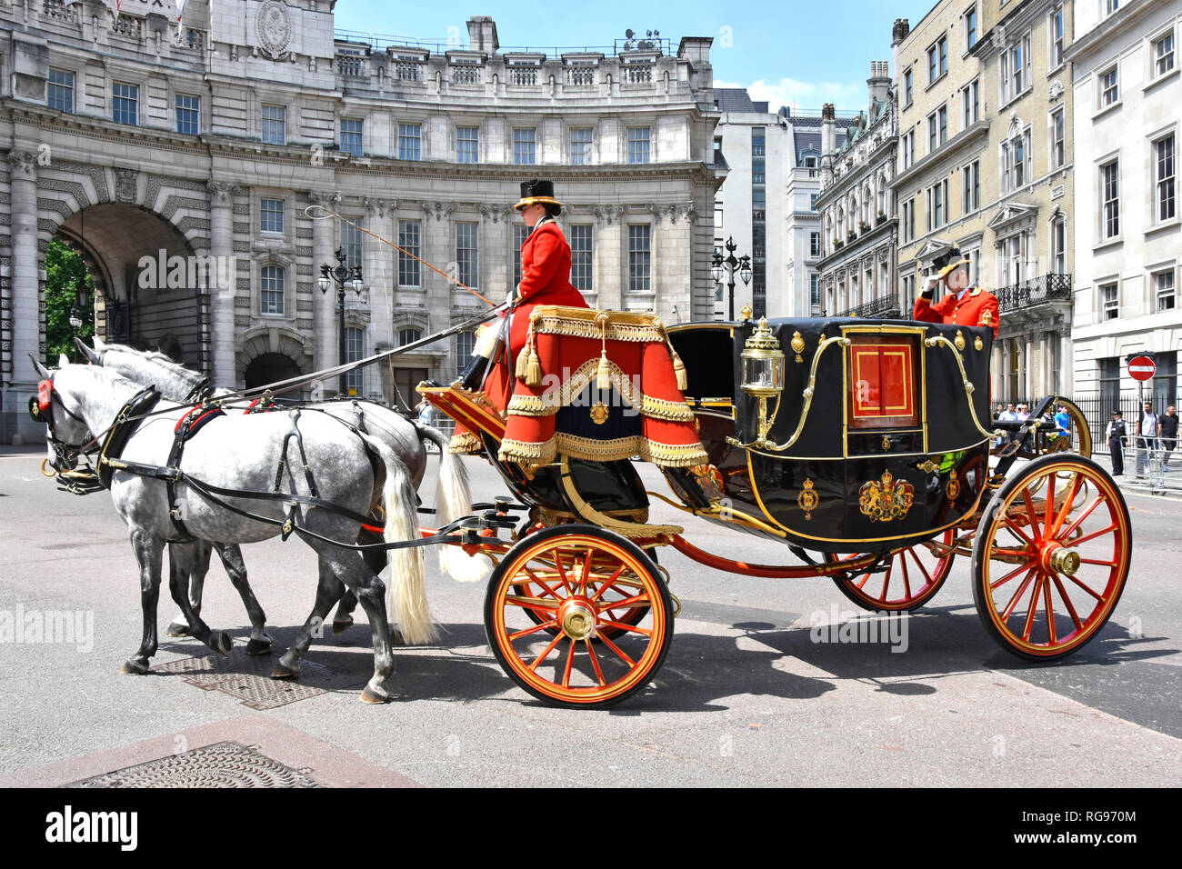 Horse drawn State Landau carriage move towards  Admiralty Arch with coachman & footman in uniform after transporting diplomatic dignitaries London UK Stock Photo