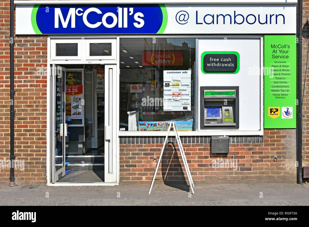 McColls convenience store & newsagent shop front window with