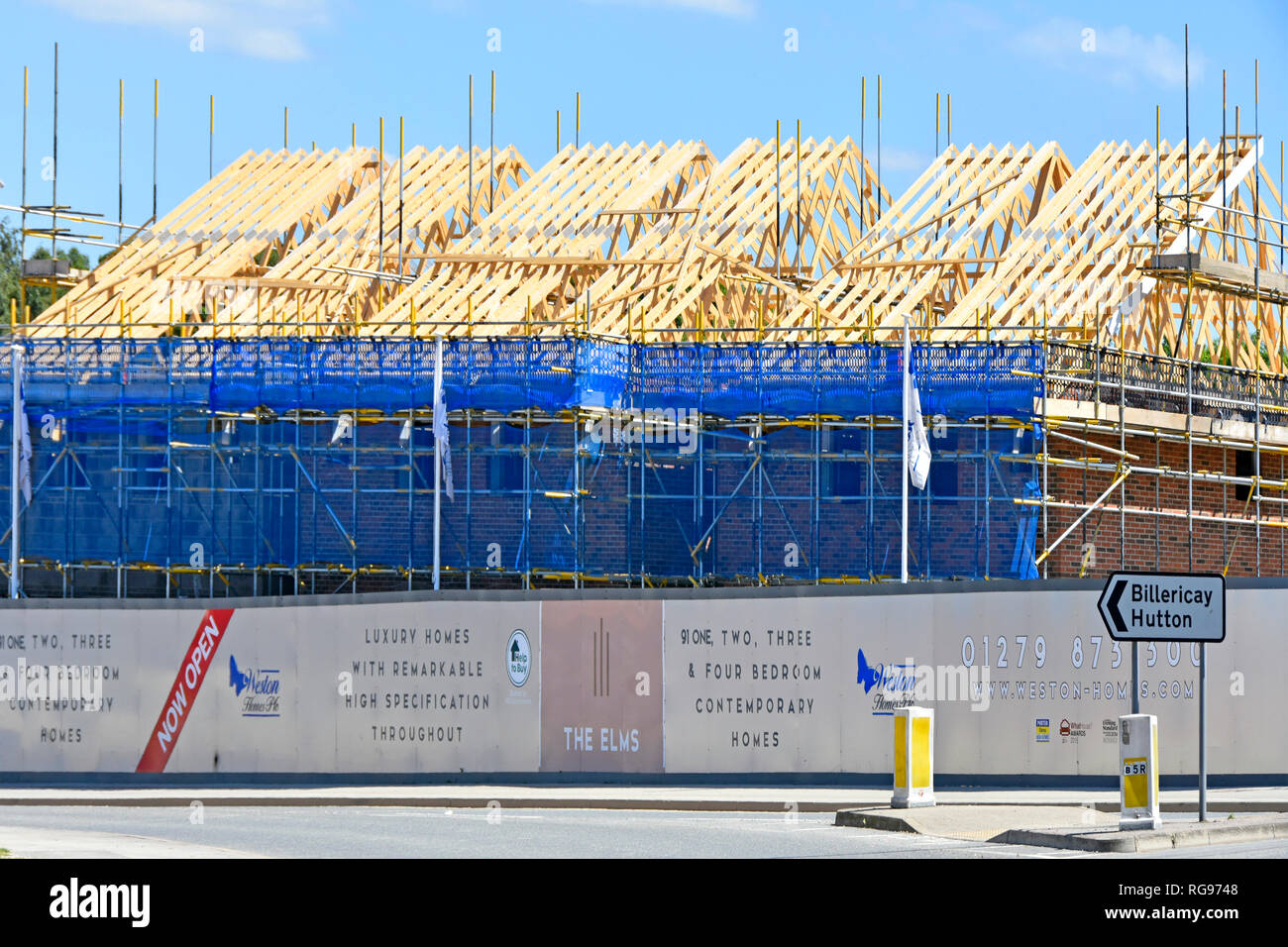 Timber Roof Scaffolding House Development Building Construction Site Of New Homes With Help To Buy Home Logo On Hoarding Brentwood Essex England Uk Stock Photo Alamy
