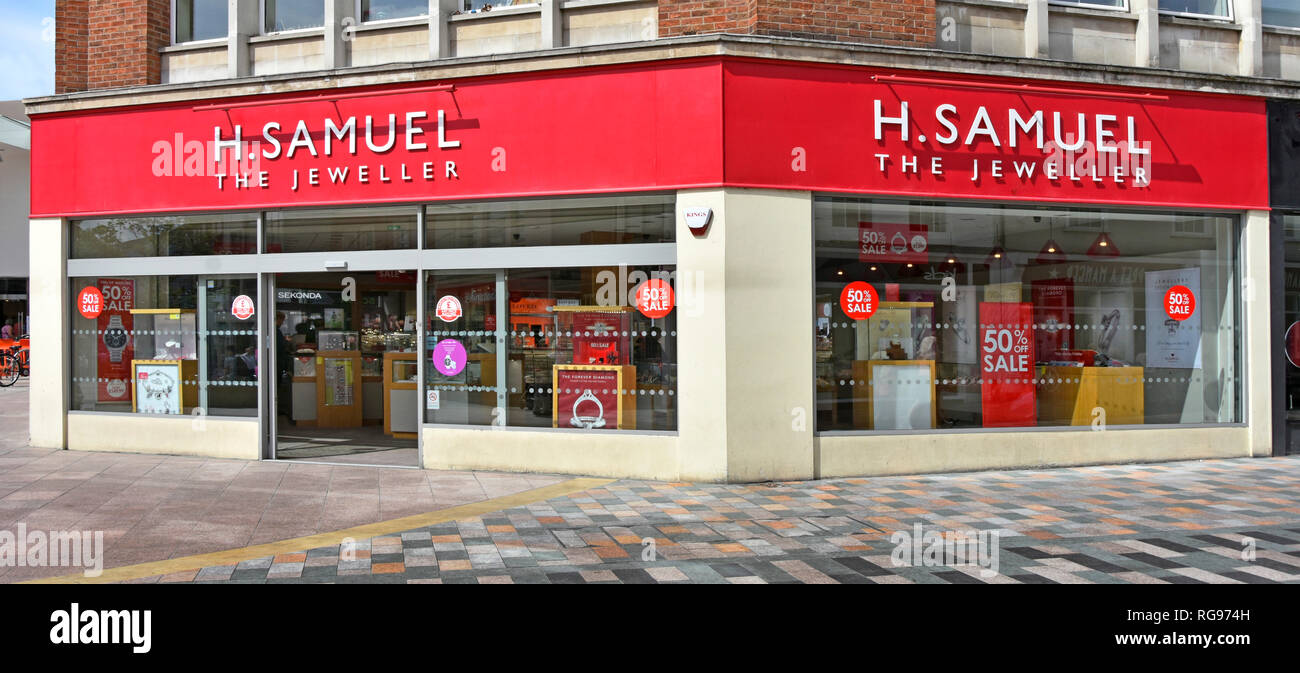 H Samuel the jeweller a jewellery store corner shop front 50% sale advertising in window & entrance off pedestrian shopping high street Chelmsford UK - Stock Image