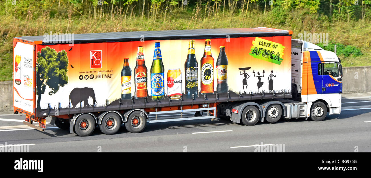 Side view of a hgv supply chain juggernaut lorry truck & articulated trailer advertising Kato enterprises Africa bottled drink import on UK motorway - Stock Image