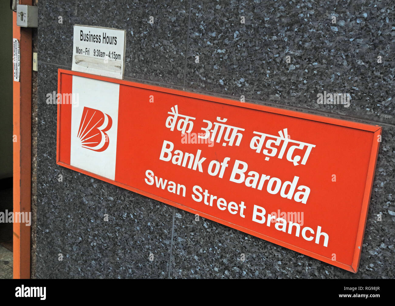 red sign, Bank of Baroda, Swan Street Manchester Branch BoB, England, UK - Stock Image