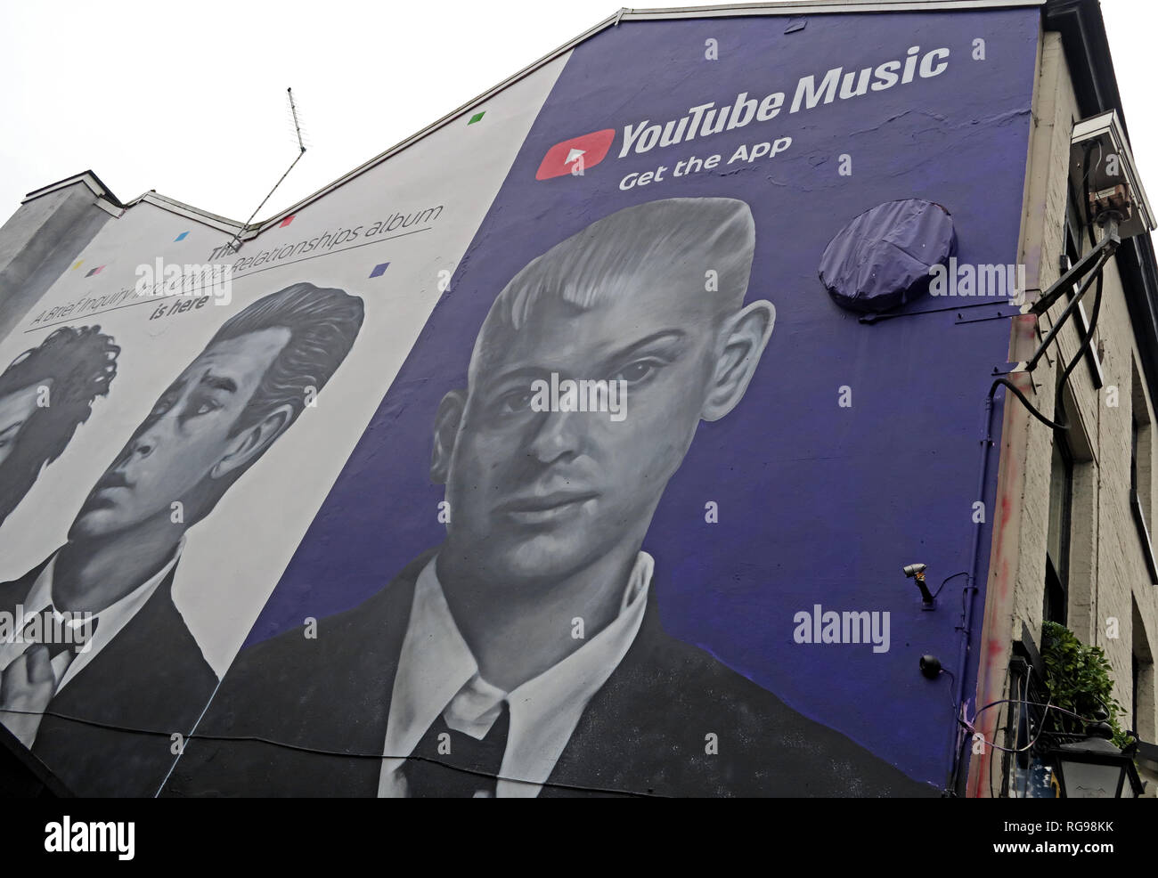 YouTube Music Get The App Advert, on gable end of building, Shude Hill, Manchester City Centre, North West England, UK, M4 2AF Stock Photo