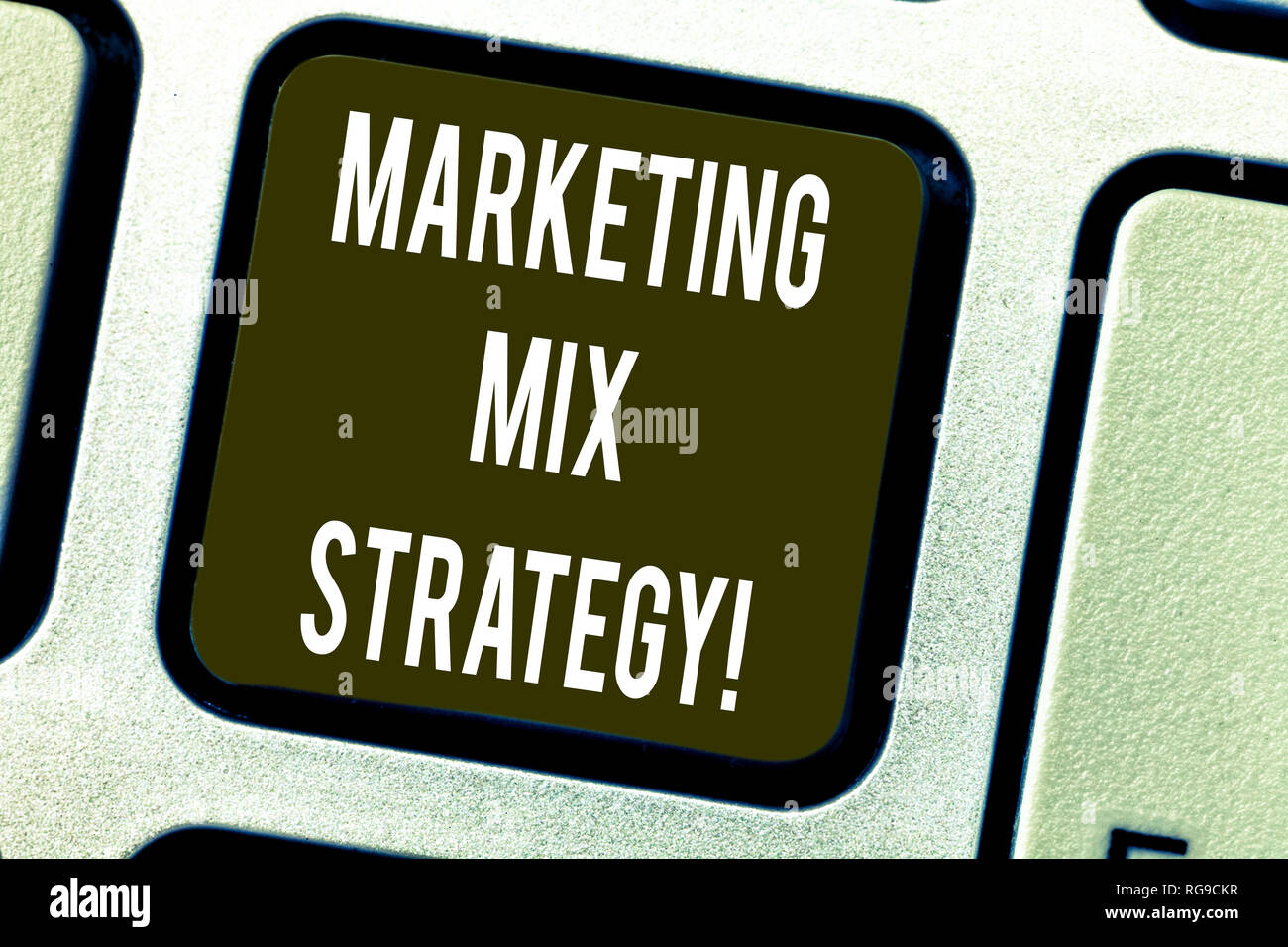 Conceptual hand writing showing Marketing Mix Strategy. Business photo text Set of governable tactical marketing tool company use Keyboard key Intenti Stock Photo