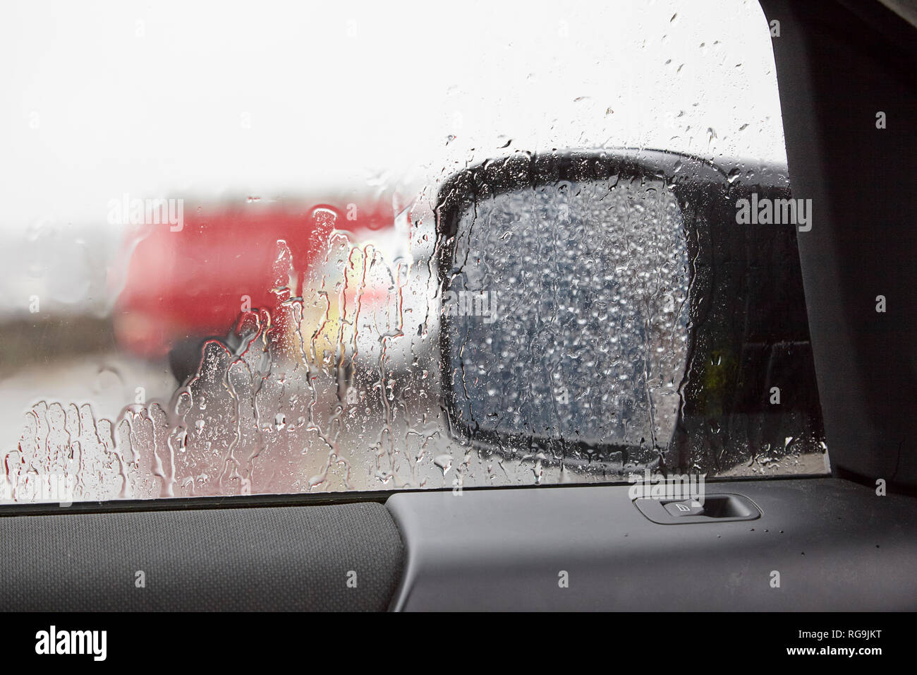 STONEHAVEN, ABERDEENSHIRE, SCOTLAND, UK, 7th July 2017. Rain soaked car side window and mirror during a torrential cloudburst. Stonehaven, - Stock Image