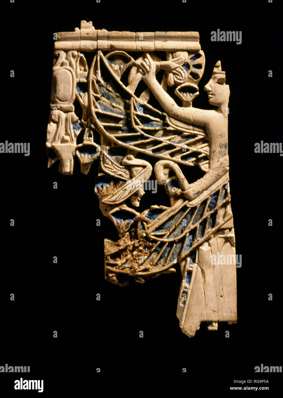 Winged male figure: Nimrud Ivory from Room SW37 Fort Shalmaneser within the Assyrian city of Nimrud, Iraq, photographed in the Iraq Museum, Baghdad. - Stock Image