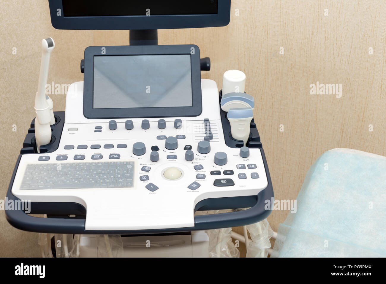 Interior of examination room with ultrasonography machine in hospital laboratory. Modern medical equipment background. - Stock Image