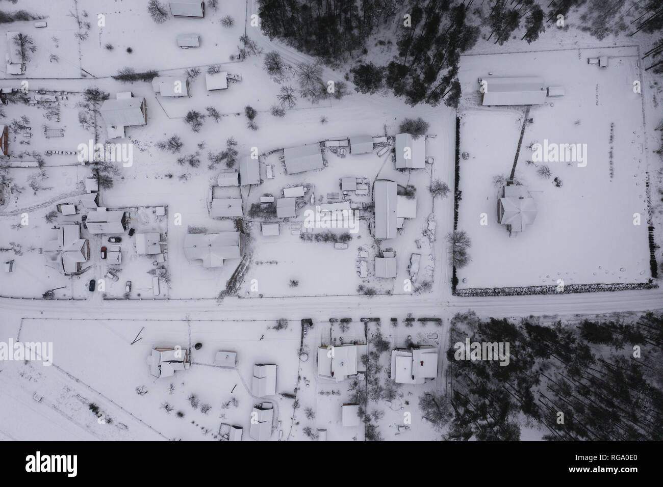 Small rural village from drone point of view during winter - Stock Image