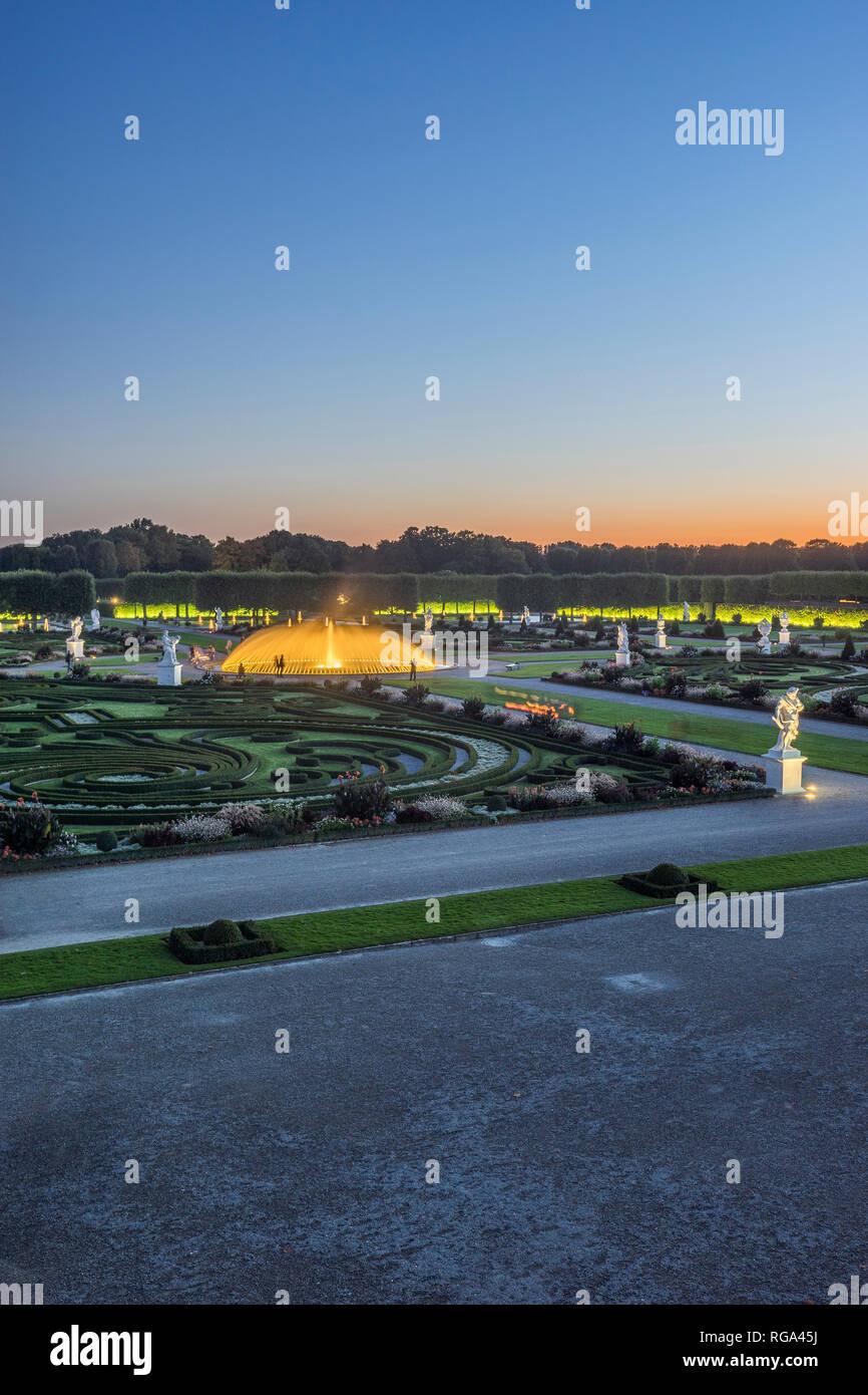 Germany, Lower Saxony, Hanover, Herrenhaeuser Gaerten, Baroque garden in the evening - Stock Image