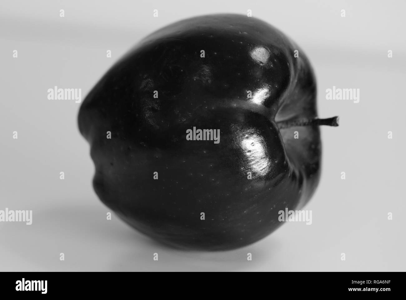 Macro photo of a Red Delicious apple. Beautiful closeup shows the details of this fruit. Black and white photo. - Stock Image