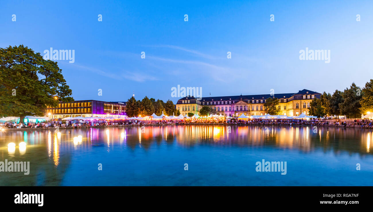 Germany, Stuttgart, palace garden, Eckensee, statehouse and New Castle during summer party - Stock Image