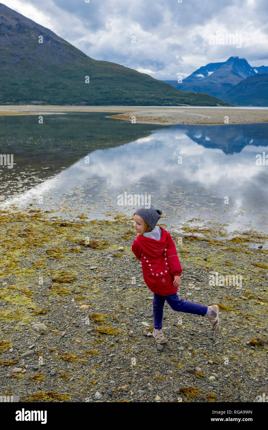 Norway, girl twisting at the beach - Stock Image