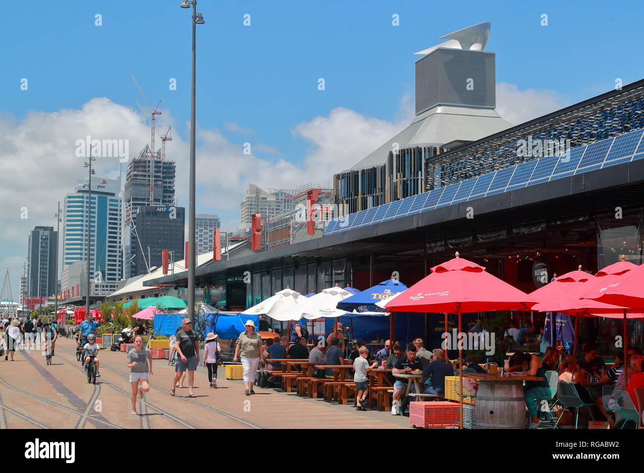 Locals and visitors alike dining in the restaurants in Auckland harbour, New Zealand - Stock Image