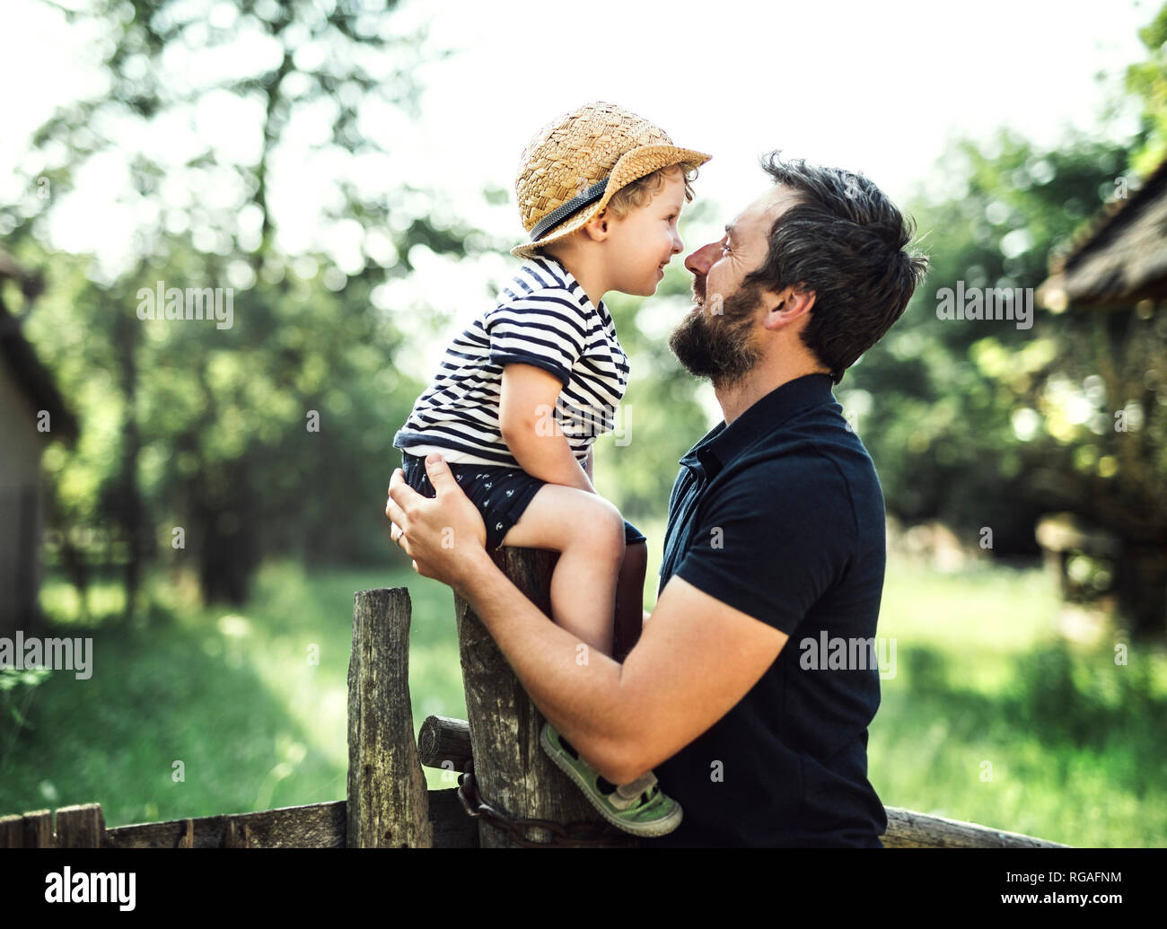 Father and little son spending time together outdoors Stock Photo