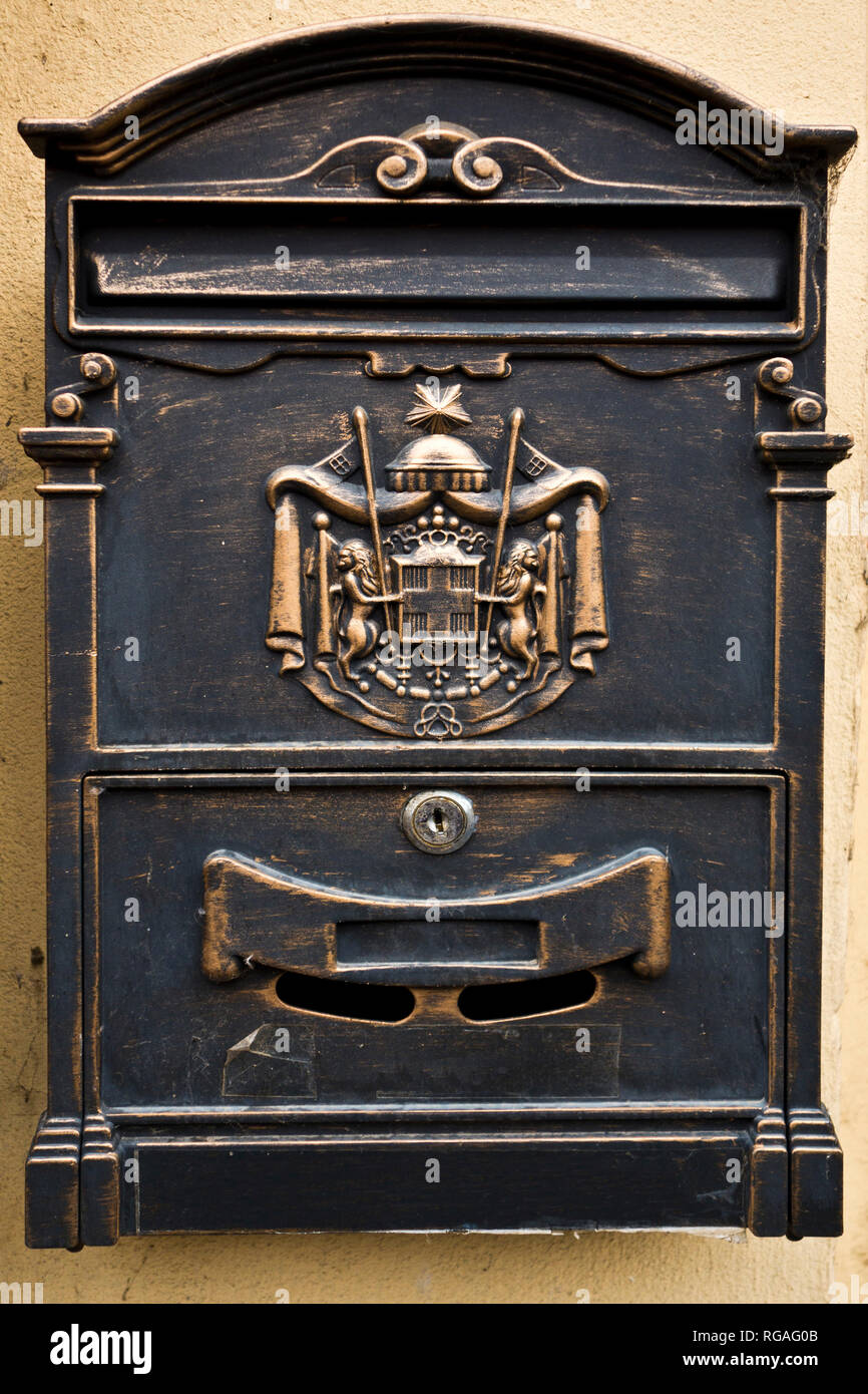 private cast-iron mail slot letter box with decoration - Stock Image