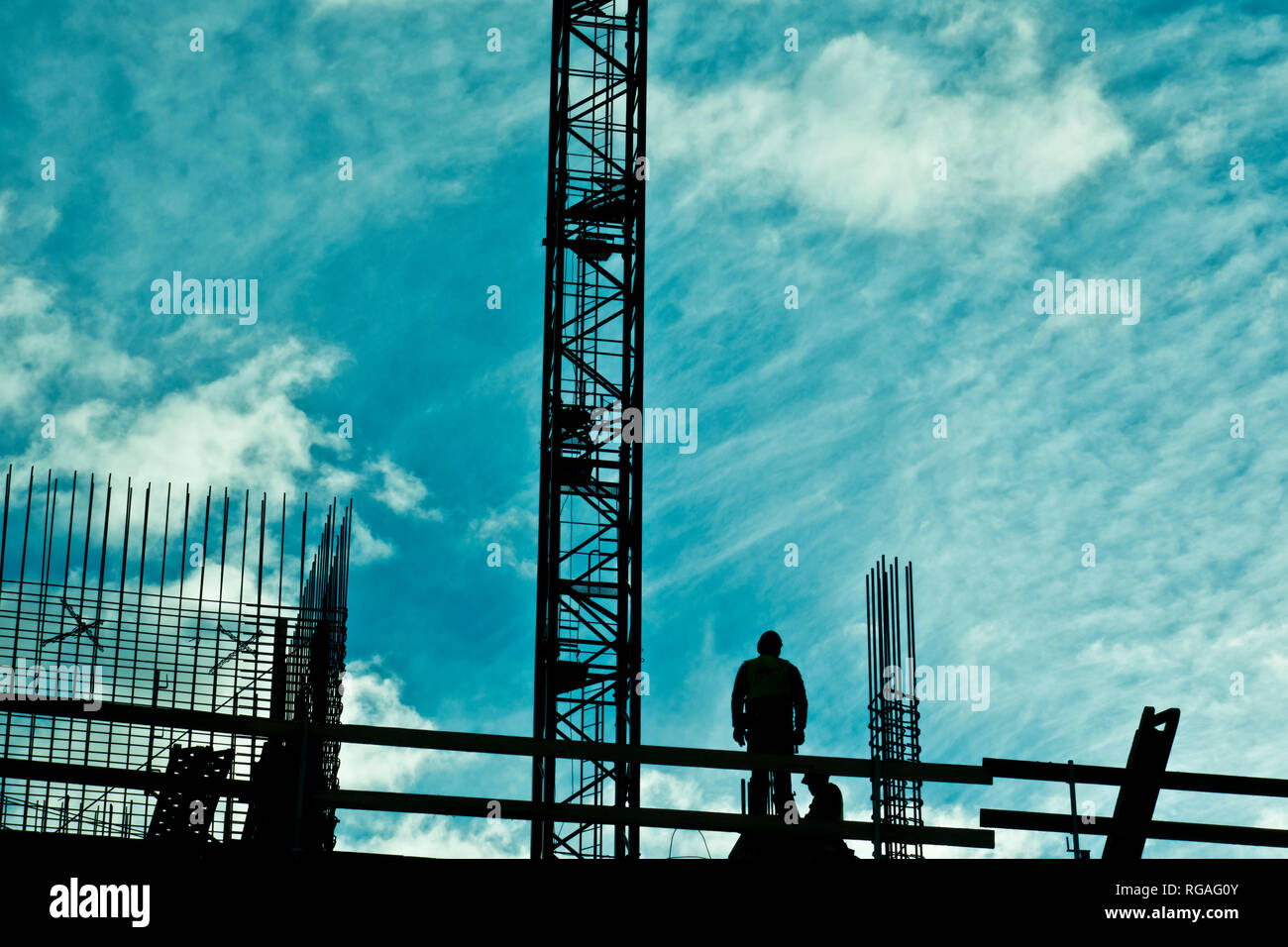 construction workers working at the construction of a multi-story building - Stock Image
