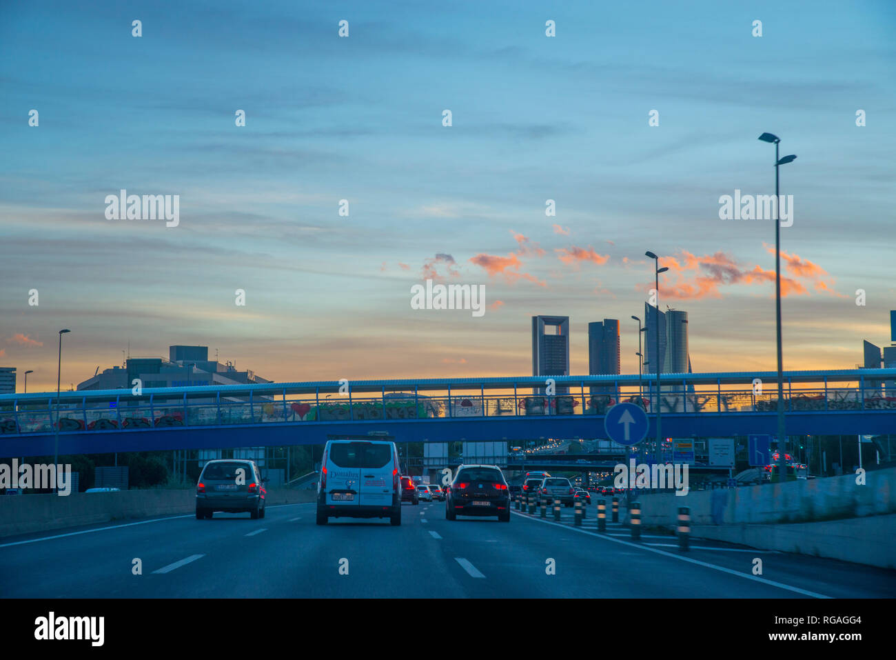 A-1 motorway and Cuatro Torres at dusk. Madrid, Spain. Stock Photo