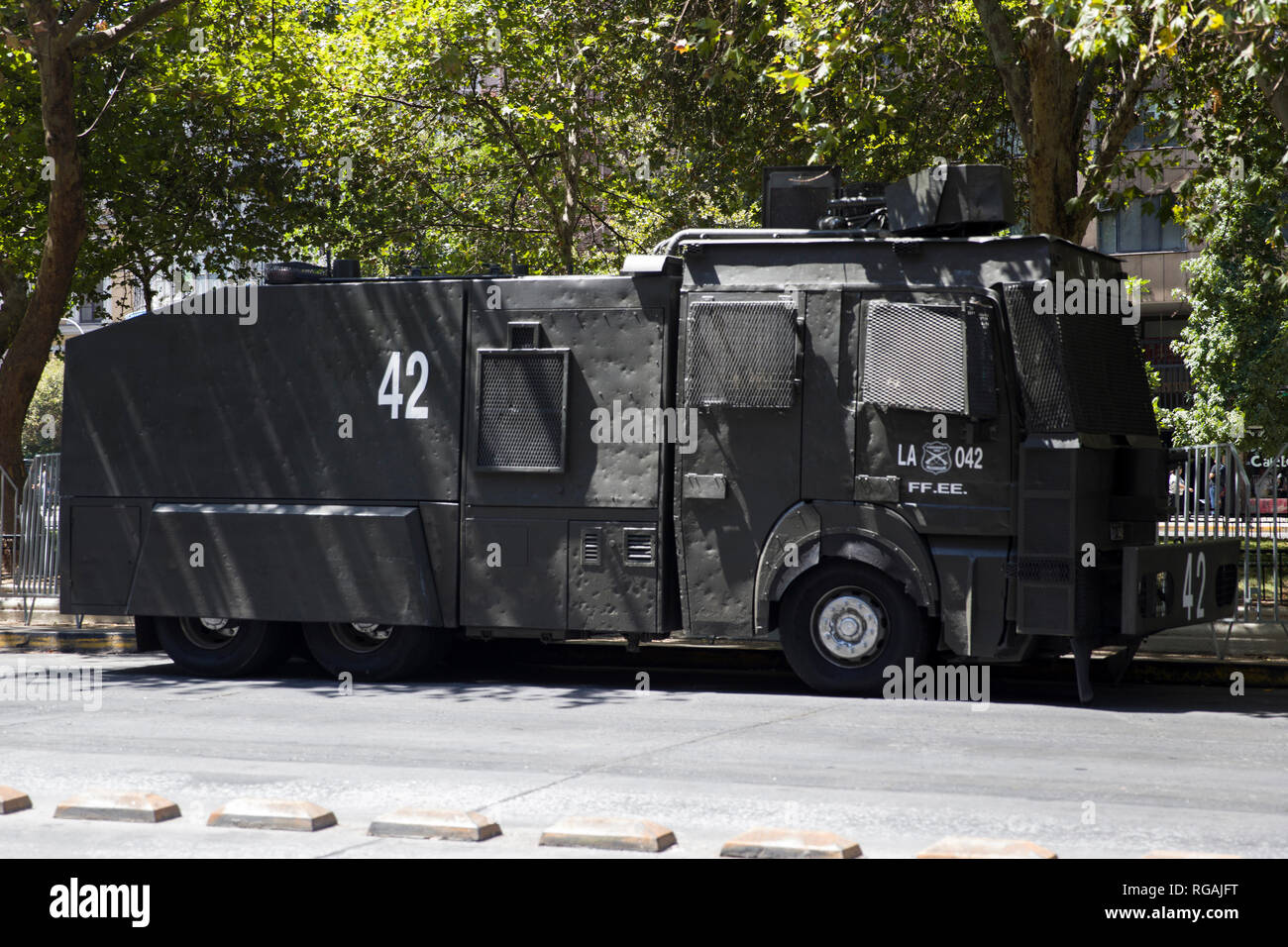Water cannon truck Mercedes-Benz Rosenbauer RWD-12200 Guanaco of Carabiniers on the street of Santiago de Chile - Stock Image