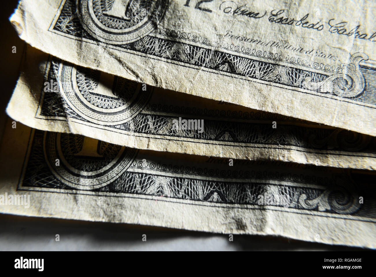 Dolar USA close-up. Old battered crumpled bills macro. The texture of the fragment of the dollar bill. USD banknote texture. Stock Photo