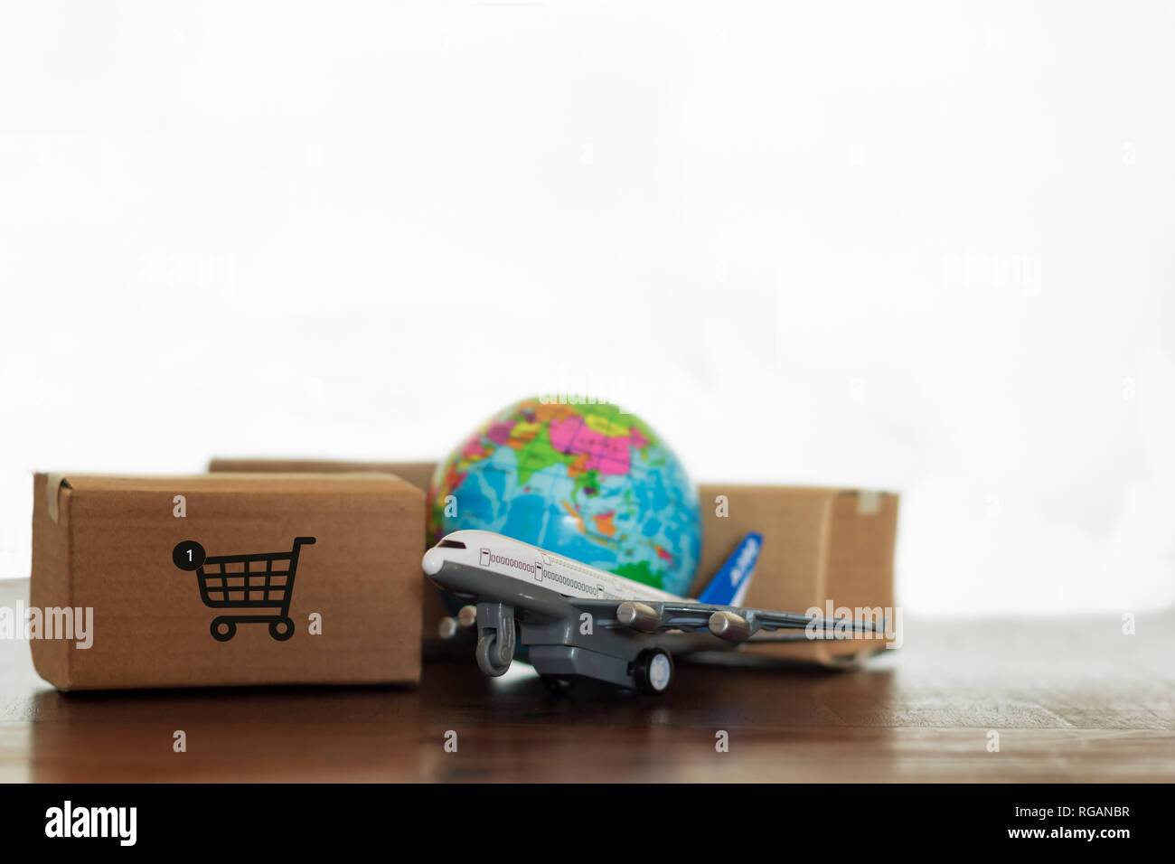 Cartons with airplane and earth globe  Online shopping