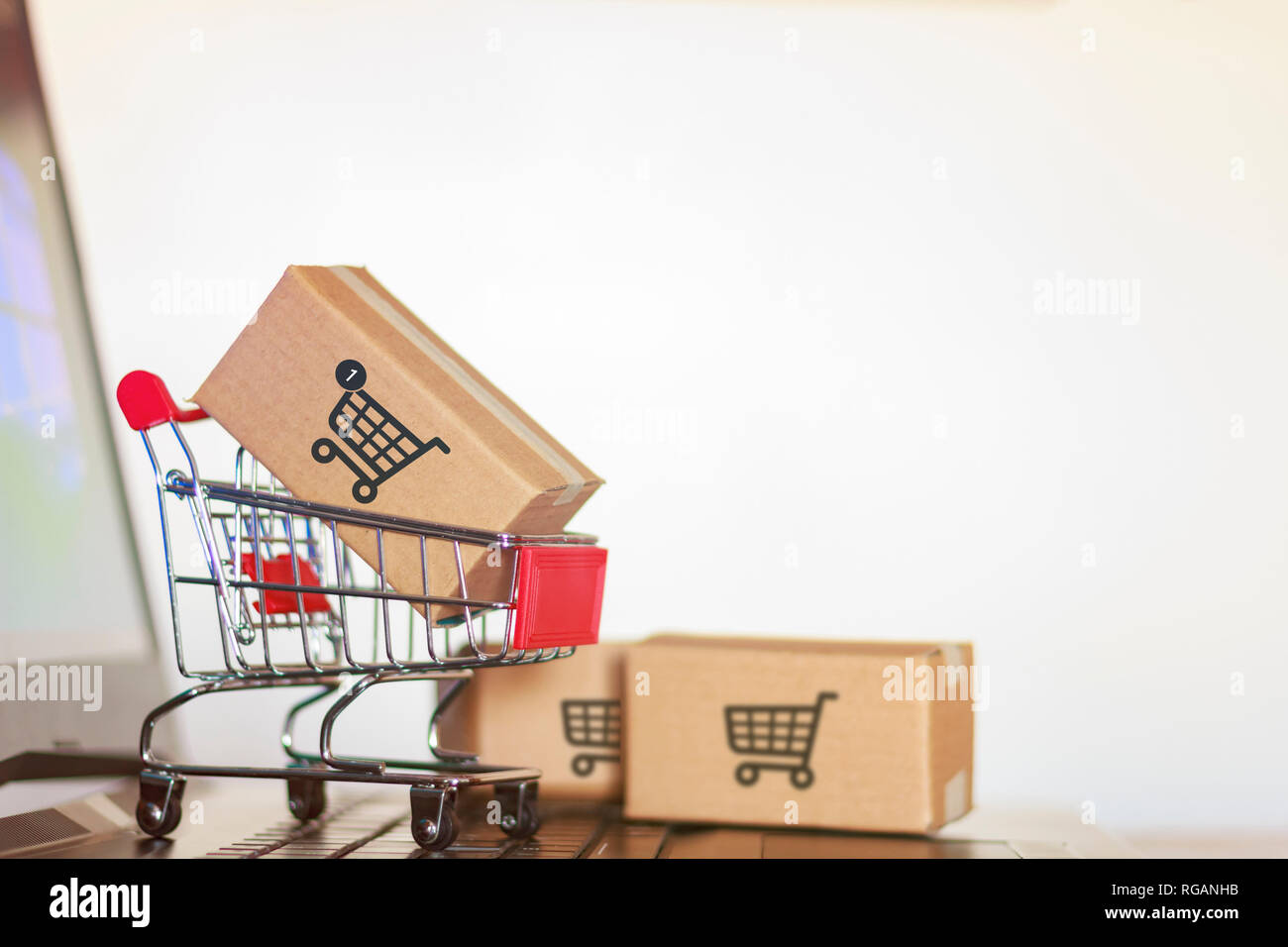 Trolley with boxes on laptop computer  Online shopping, e