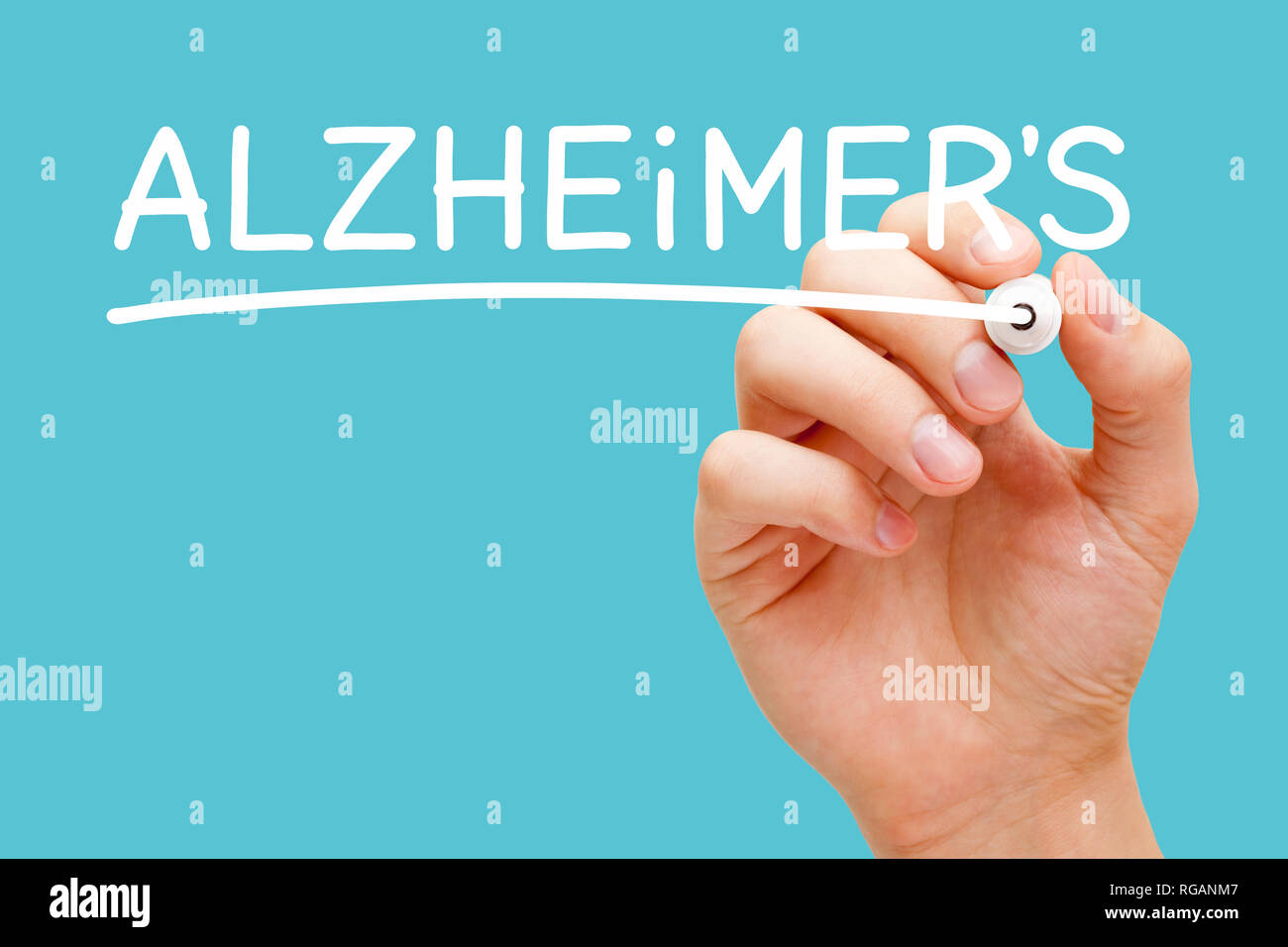 Hand writing Alzheimer's disease with white marker on transparent wipe board isolated on blue background. - Stock Image