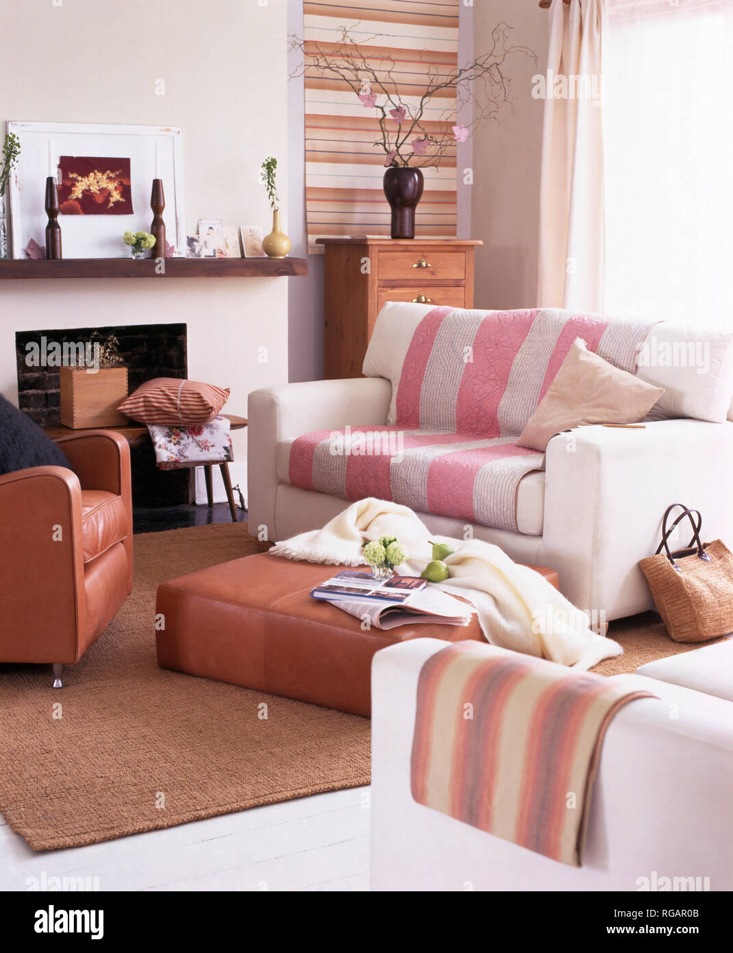 Striped Throws On White Sofas In Modern Living Room Stock Photo
