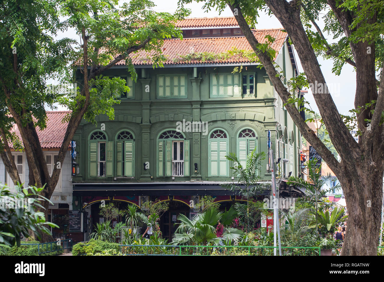 A green colour conserved shophouse along Ophir Road, or commonly known by local or tourists as Arab Street or Kampong Glam, Singapore. - Stock Image