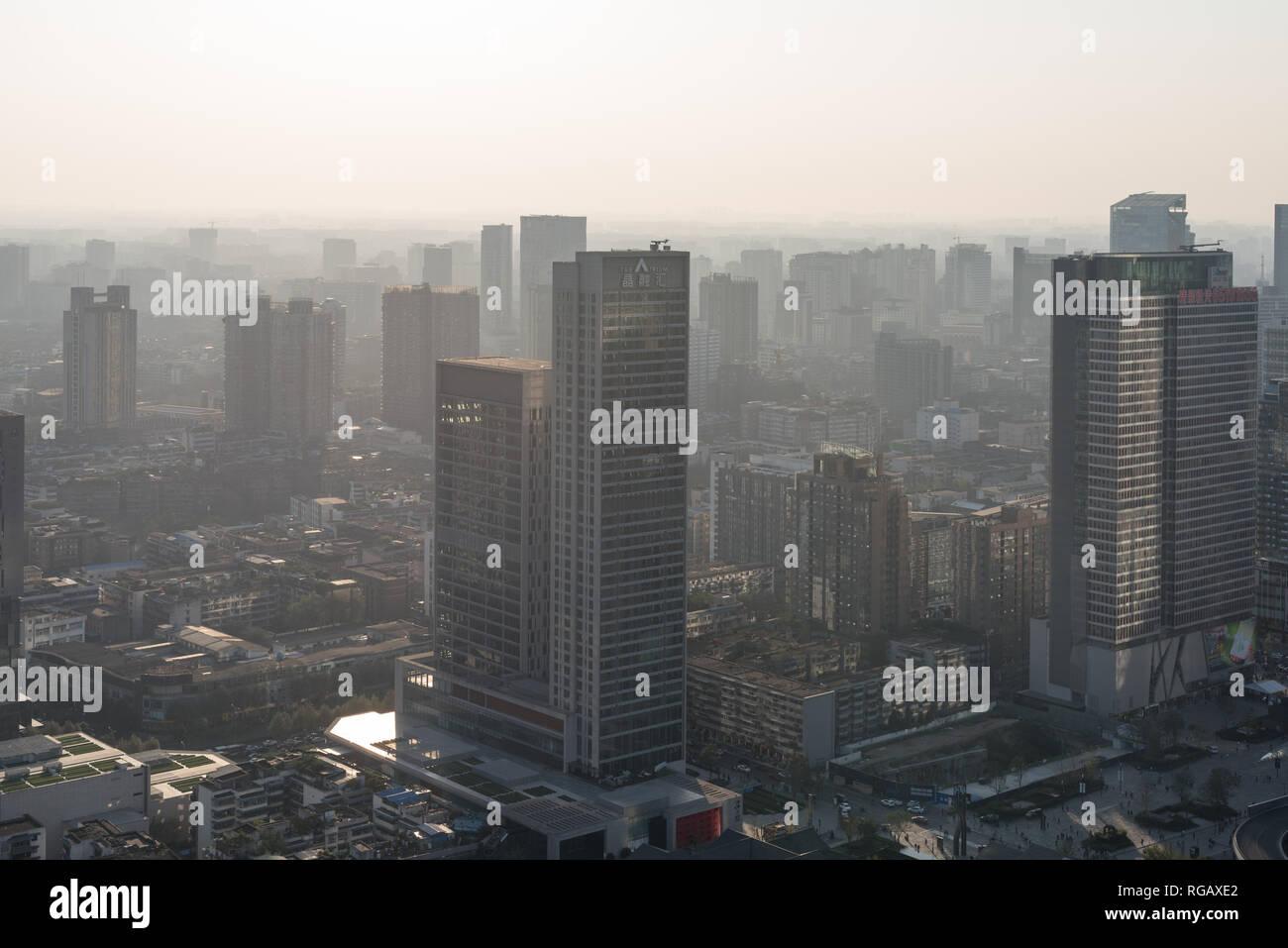 Chengdu, Sichuan province, China - Nov 8, 2015: Chengdu skyline aerial view in the haze Stock Photo