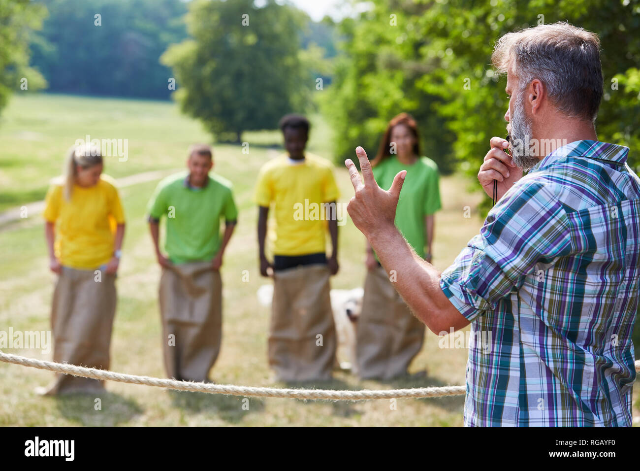 Group at the start of the sack race competition as a team building event - Stock Image
