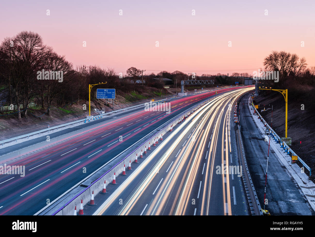 Light trails on the M6 motorway at Sandbach in Cheshire at dusk - Stock Image