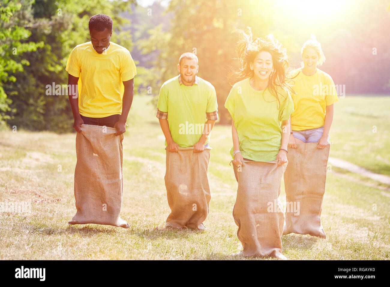 Group makes sack jumping as teambuilding event in summer - Stock Image