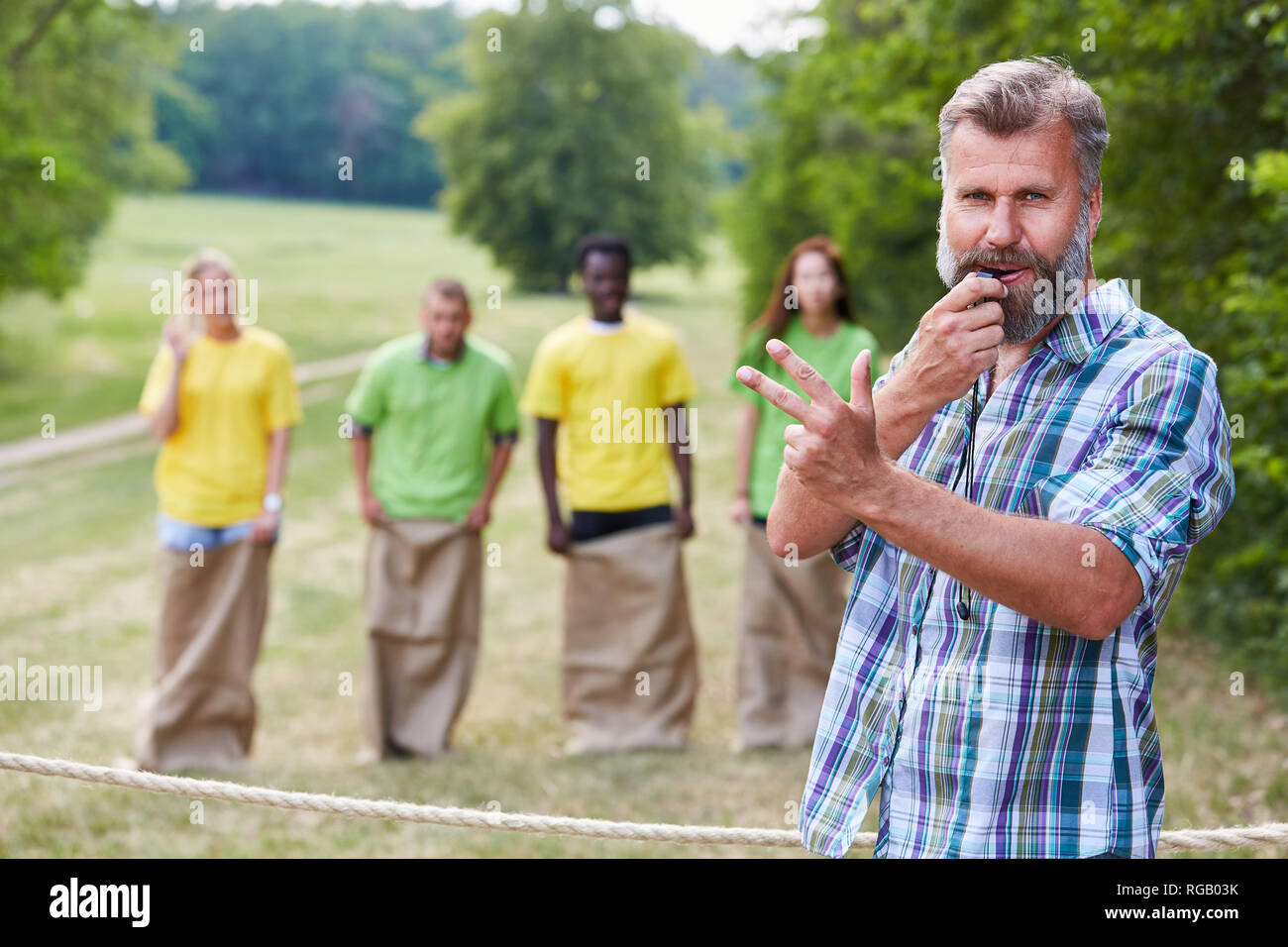 Referee just before the start of the sack race competition as a sports event - Stock Image