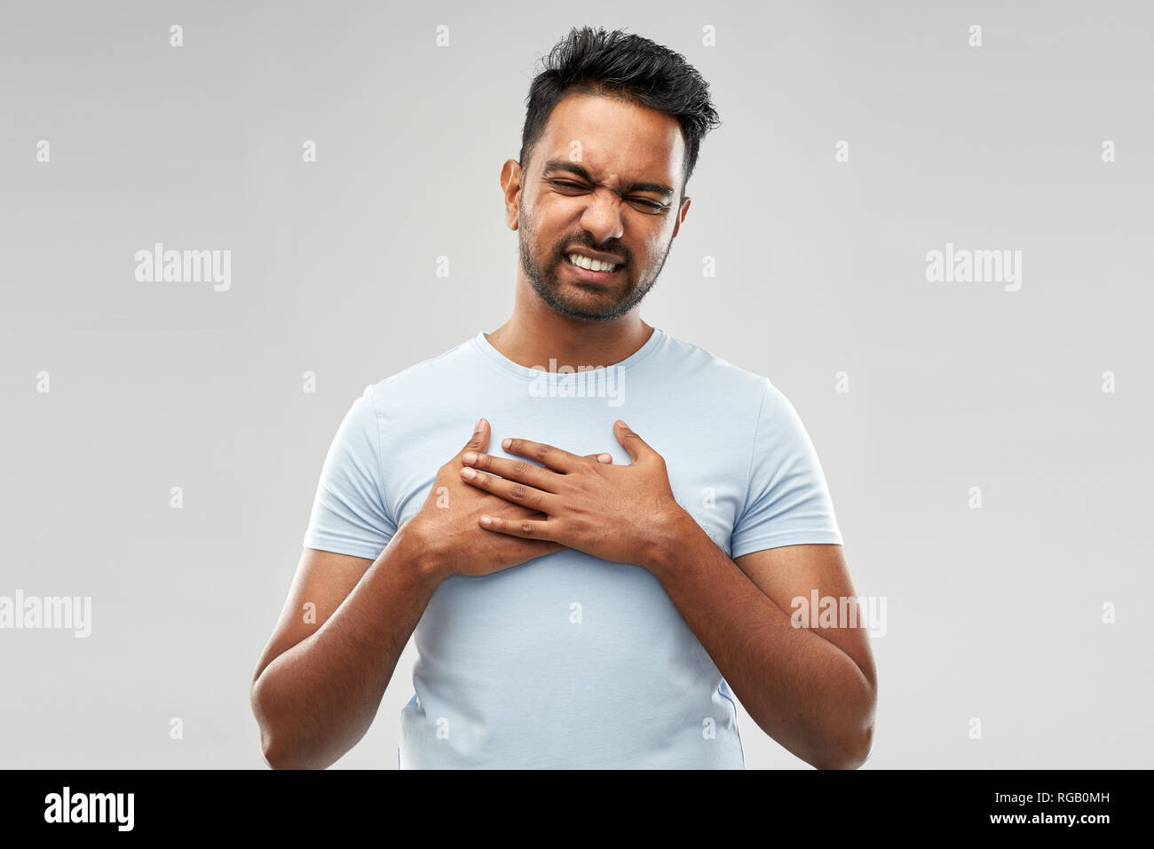 unhappy indian man suffering from heartache - Stock Image