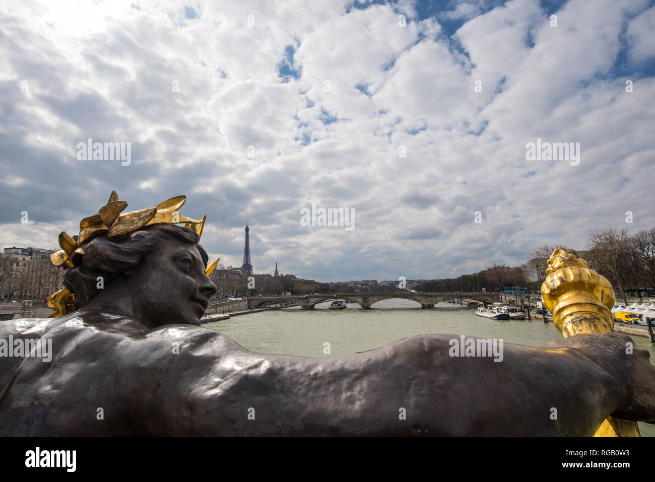 Antique statue on bridge Alexandre III, the river Seine and the Eiffel tower, Paris, France - Stock Image