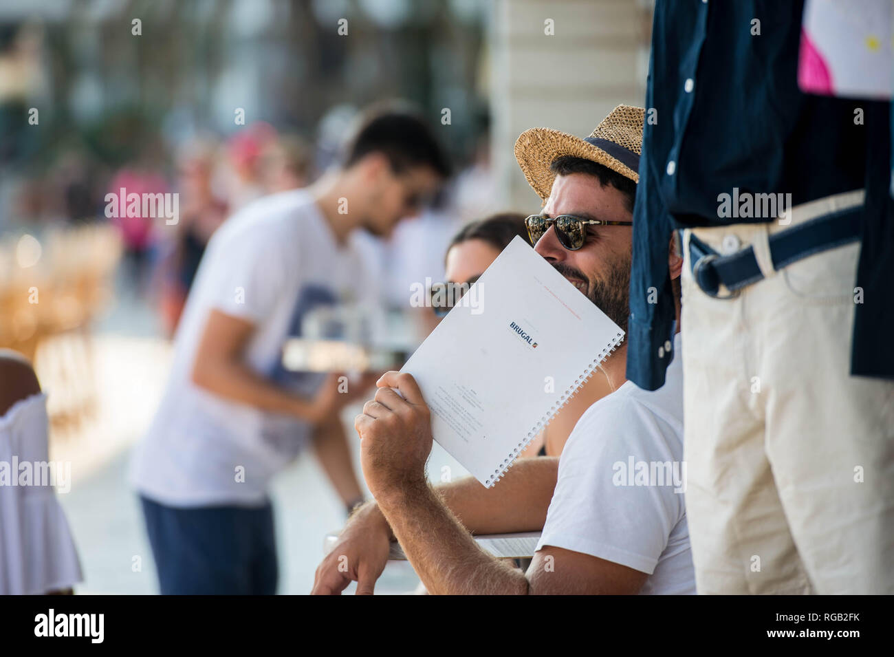Friday  31 August 2018  Pictured: A man grins on the street with a straw hat  Re:  General Views of Hvar, Croatia - Stock Image