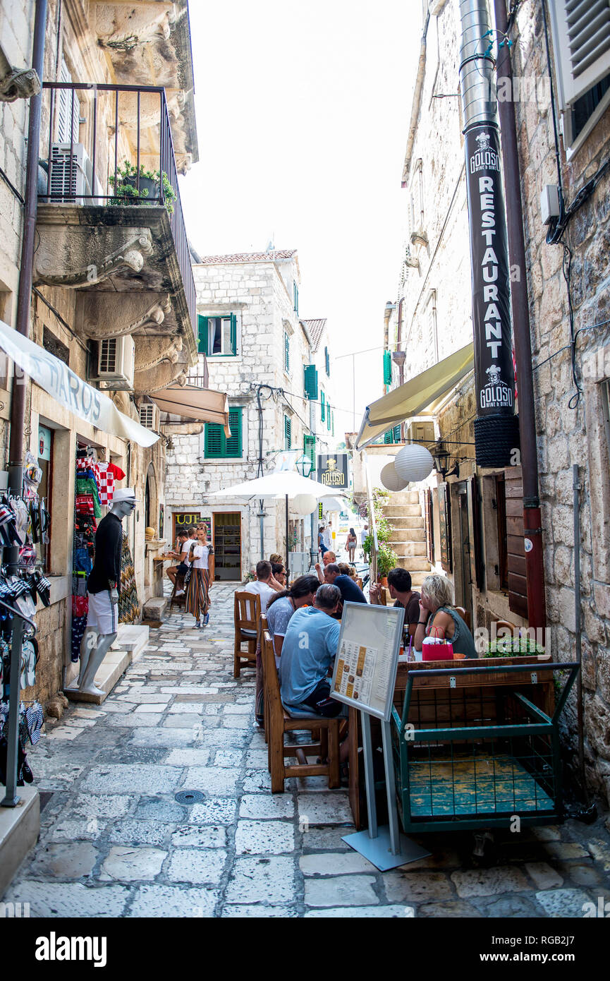 Friday  31 August 2018  Pictured: Narrow Street in Hvar with people eating alfresco out doors Re:  General Views of Hvar, Croatia - Stock Image