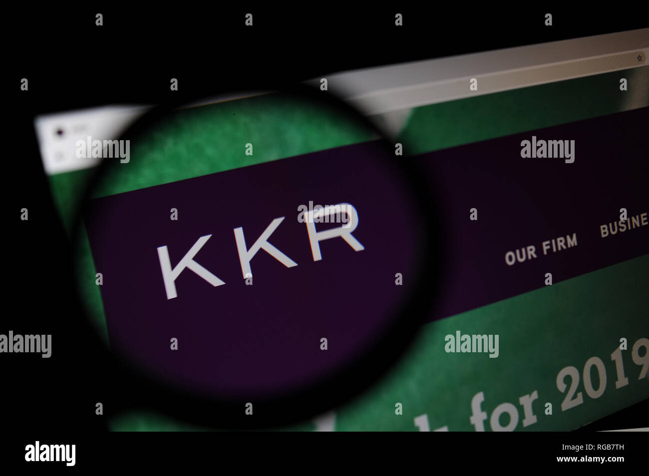 The private equity firm KKR & Co. Inc website seen through a magnifying glass - Stock Image