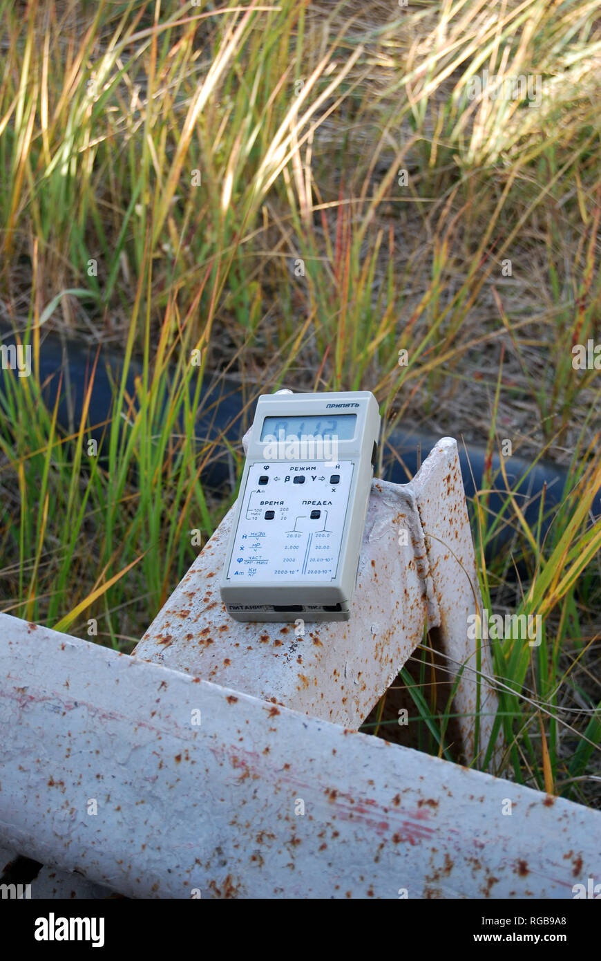 A Geiger Counter showing a radiation reading from within the Chernobyl Exclusion Zone in Ukraine - Stock Image