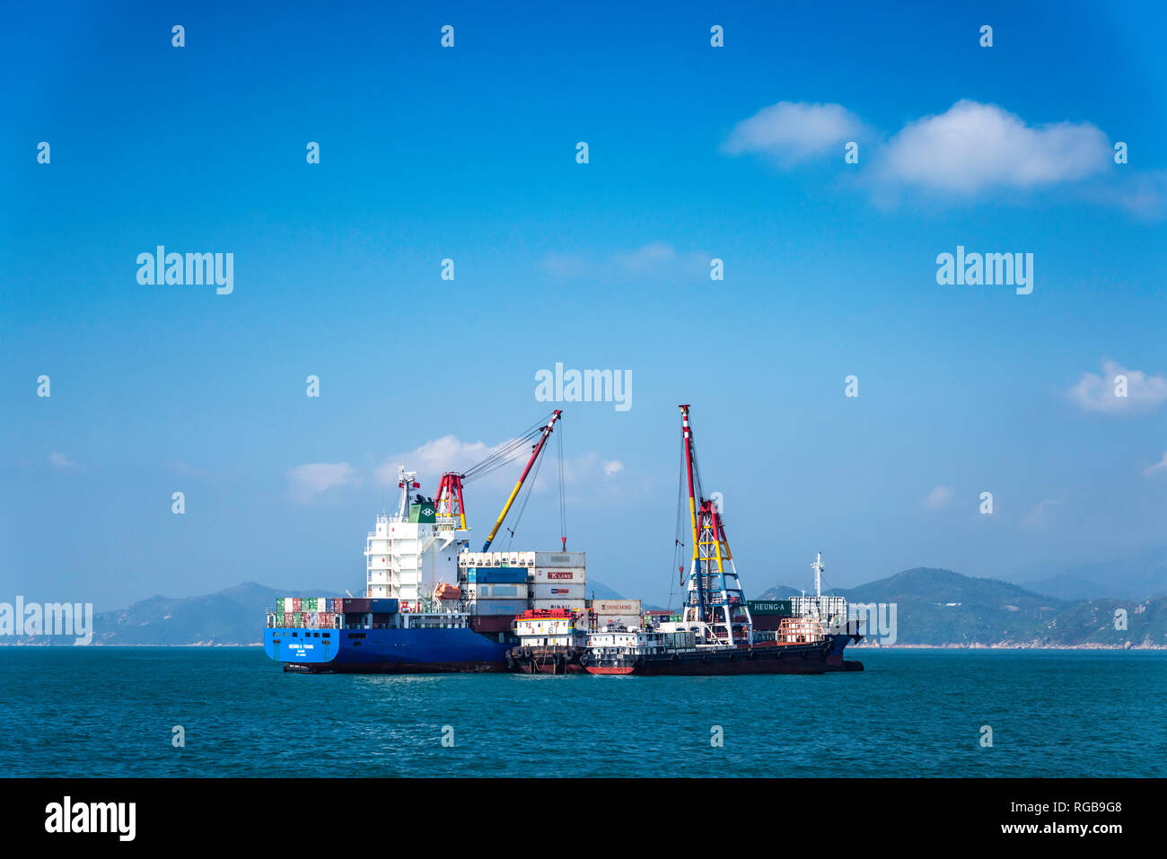 Cargo ships anchored in Victoria Harbor, Hong Kong, China, Asia. - Stock Image
