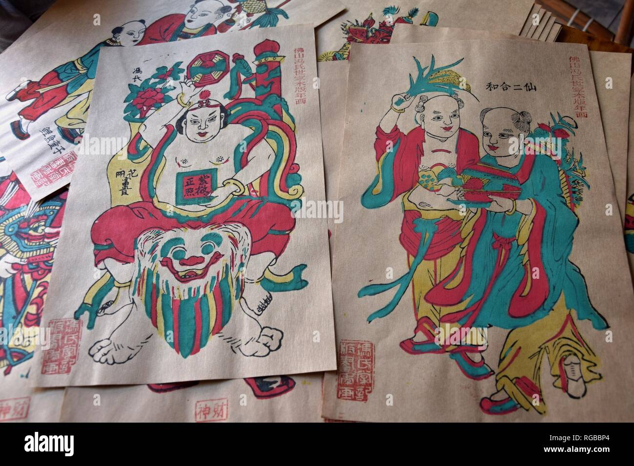 Chinese colored woodblock prints, for decoration during the Chinese New Year Holiday, then later used to depict current events. - Stock Image