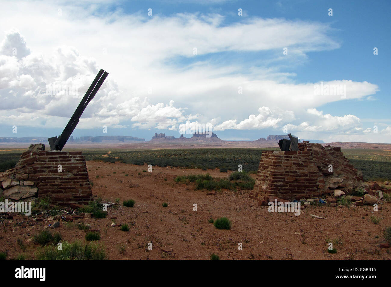 Filming location of movie Once Upon a Time in the West, directed by Sergio Leone. Remains of brick arch of the hanging scene. Monument Valley on back. - Stock Image