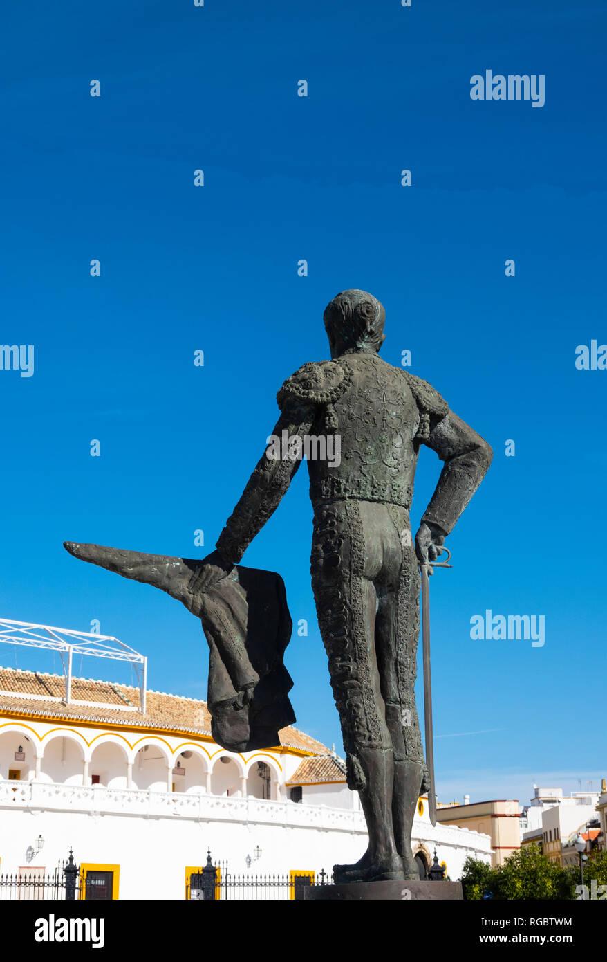 Statue of matador Pepe Luis Vazquez across from the Plaza de toros de la Real Maestranza de Caballería in Seville, Spain - Stock Image
