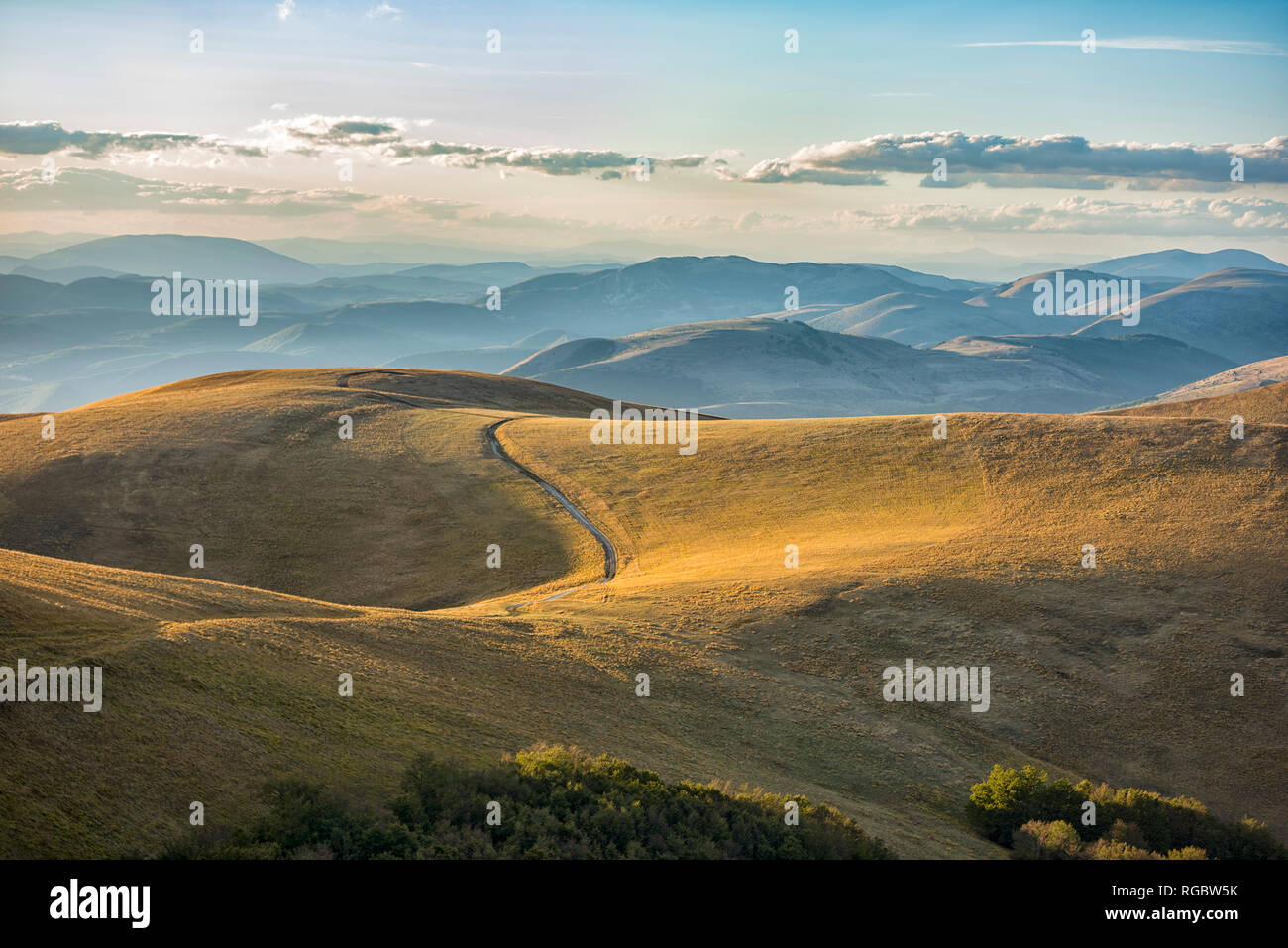 Italy, Umbria, Sibillini Park, Dirt road in the hills - Stock Image
